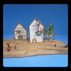 Houses on driftwood by Anya Keeley