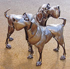Two Dogs - steel sculpture by Duncan Thurlby