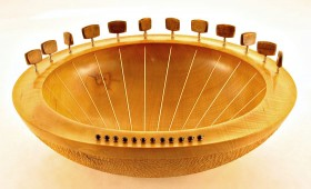 "A twelve string Lyre style Sounding Bowl in Sycamore.  20"" across by about 5"" deep with Walnut tuning pegs. Tuned from E' - B. Handmade in Devon"
